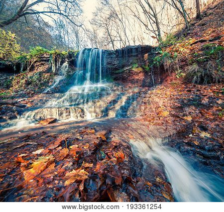 Sunny Autumn View In The Forest With Pure Water Waterfall.