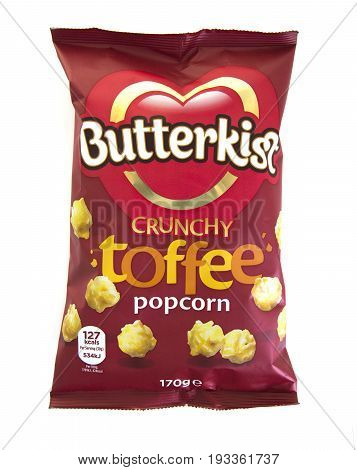 SWINDON UK - JUNE 1 2017: A packet of Butterkist Crunchy Toffee Popcorn on a white background
