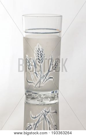Glass beaker with engraving on white background