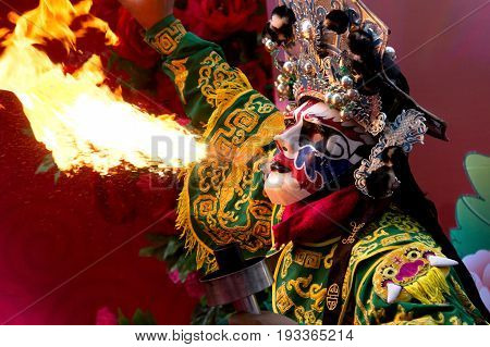 Bangkok Chinese New Year Chinese Opera actor perform spitting fire in the traditional face-changing