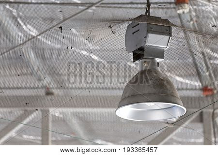 dirty Industrial lamp High Bay Lighting in factory.
