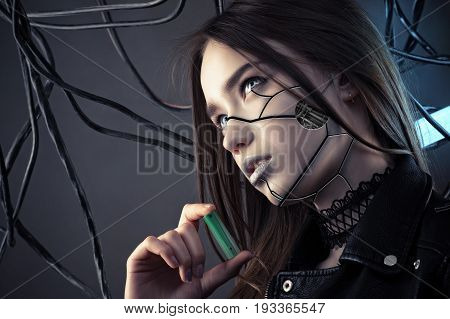 charming robot girl with cyberpunk style makeup holding battery in hand, concept energy saving