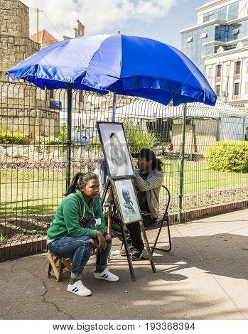 Antananarivo Madagascar - June 16 2017 : Malagasy portraitist street. Artists hand sketching portrait in the street in Antananarivo Madagascar.