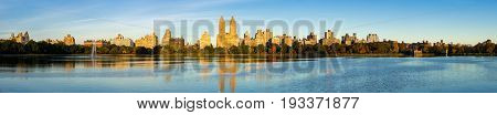 Panoramic morning view of the Upper West Side with the Jacqueline Kennedy Onassis Reservoir and Central Park in Fall. Manhattan New York City