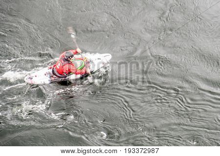 Blurred slow shutter speed shot of a canoe driver with copy space, aerial