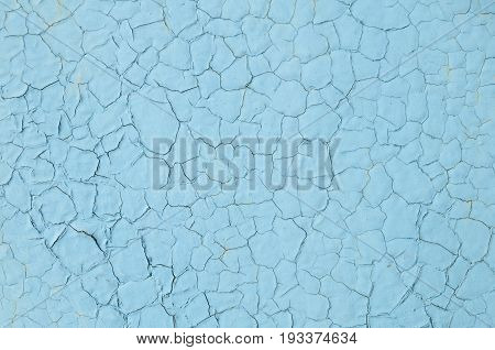 Texture of cracked colorless blue paint board