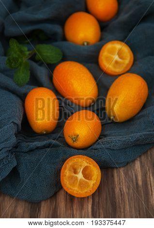 Kumquats On A Textile Napkins