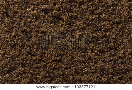 Potting soil flat surface. Also called potting mix or compost, a medium to grow plants with peat, also called turf. Backgrounds. Closeup macro photo directly from above.
