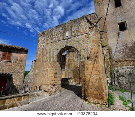 Medieval gate with old noble emblem of the ruined walls of of Faleria a small town near Rome