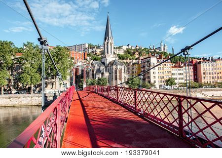 Morning view on the red footbridge and the riverside in the old town of Lyon city