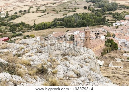 a view over Huesa del Comun town and the San Miguel church, Teruel, Spain