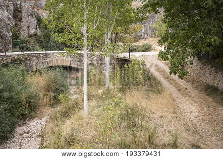 ancient bridge over a dry river at Huesa del Comun, Teruel, Spain