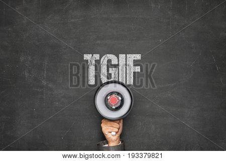 Cropped image of businessman holding megaphone under TGIF text on chalkboard