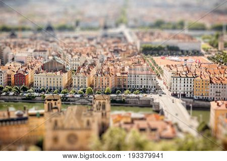 Aerial cityscape view on Lyon with Rhone river during the morning light in France. Tilt-shift image technic