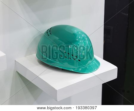 Turquoise Safety helmet on a shelf white background; Working Hard Hat;Personel Protection Equipment PPE;clipping mask