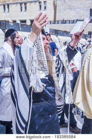 JERUSALEM - APRIL 13 : Orthodox jewish men prays in The western wall during Passover on April 13 2017 The Western wall is important Jewish religious site located in the Old City of Jerusalem