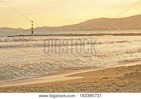 Surfers At Molinar Beach