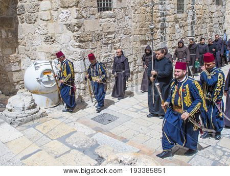 JERUSALEM - APRIL 13 : A procession of monks during Easter in the church of the holy sepulcher in Jerusalem Israel on April 13 2017