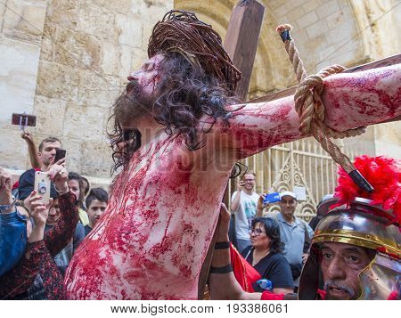 JERUSALEM - APRIL 14 : Christian pilgrim re-enact the crucifixtion of Jesus along the Via Dolorosa in Jerusalem during Good friday on April 14 2017