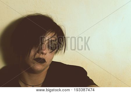 Depression. Depressed girl with black lipstick. Sadness. Loneliness.