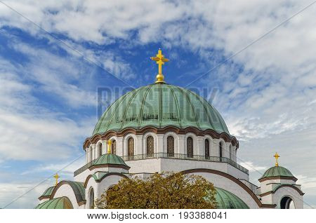 The top of Saint Sava christian catedral with blue cloudy sky in the capital Belgrade