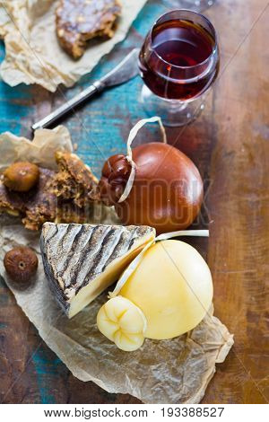Sweet Dessert Liqueur Wine In Glass, Hard Cheeses Caciocavallo Or Provolone, Tomme De Montagne, Drie