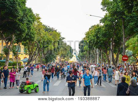 Hanoi Vietnam - Feb 19 2107 : People walking on Dinh Tien Hoang the walking street by Hoan Kiem lake center of Hanoi