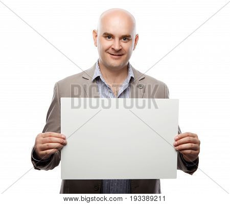 Happy bald man showing and displaying placard ready for your text or product. Isolated on white background with clipping path.
