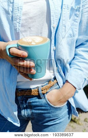 Female Hipster Person Holding A Cup Of Cappucino. Lifestyle Summer Portrait