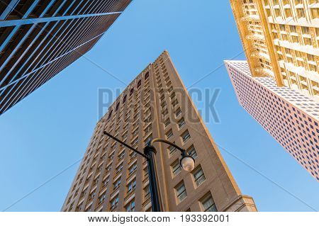 Bottom view of streetlight and skyscrapers on the background of clear sky Atlanta USA
