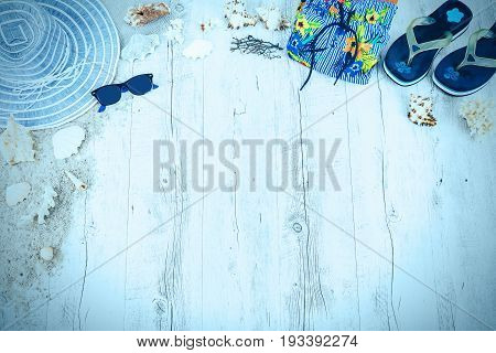 Sand and shells and hat on the wooden floor of the blue, summer concept, travel Seychely, beach Florida, Hawai, swimm in Bali, summer pradise