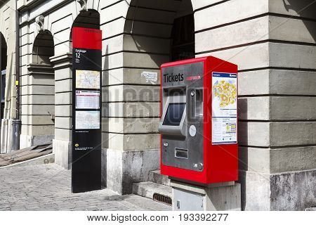 Bern Switzerland - April 17 2017: Self-service tickets machine at Zytglogge trolleybus station. There is a visible post with a timetable