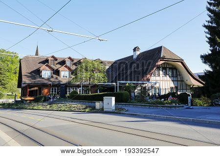 Muri bei Bern Switzerland - April 13 2017: Traditional building with elements of roof architecture characteristic of the region. There is a hotel and a restaurant right now.