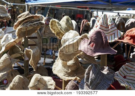 Bern Switzerland - April 20 2017: Variety of hats put on sale in temporary market which was created on one of the squares in the city. These are folk product.