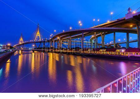 Bhumibol bridge 2 so called Industrial Ring Bridge crossing The Chao Phraya River with reflection Bangkok Thailand ( foreign text saying Bhumibol bridge 2 )