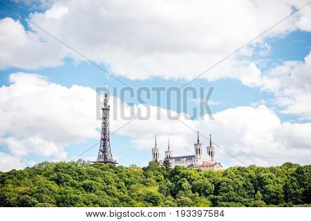 View on the mountain with Notre-Dame cathedral and metallic tower in Lyon city in France