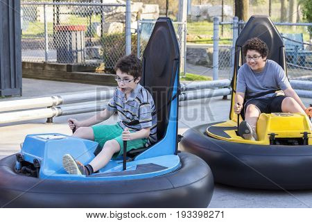 One Boy Chasing Another With A Bumper Car