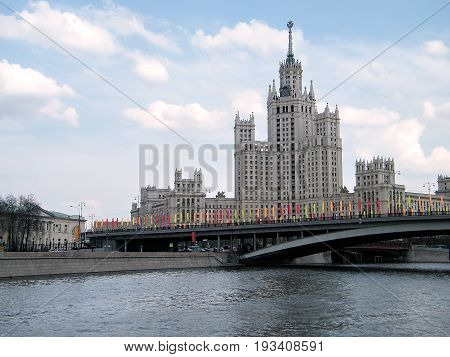 Viev to Highrise building on Kotelnicheskaya quay from Moscow river at evening in Moscow Russia