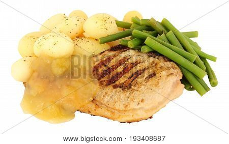 Grilled pork chop meal with boiled potatoes and apple sauce isolated on a white background