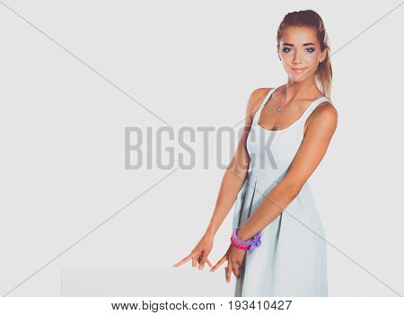 Young woman standing near blank board banner ,isolated on white background