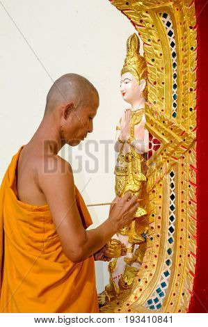 Chiang Mai Thailand - 8 January 2016: monk restoring a sculpture at the Wat Phra That Doi Suthep temple of Chiang Mai on Thailand