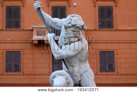 ROME, ITALY - SEPTEMBER 02: Piazza Navona, Neptune fighting with an octopus statue in the Fountain of Neptune in Rome, Italy on September 02, 2016.