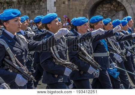 ROME ITALY - JUNE 2 2017: Military parade at Italian National Day. Soldiers in formation including women. Picture is taken between Piazza Venezia and Teatro di Marcello.
