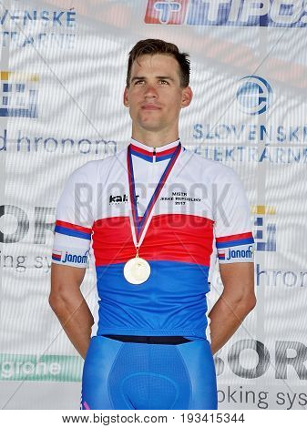 ZIAR NAD HRONOM, SLOVAKIA - JUNE 26, 2017: The Slovak and Czech National road cycling championship. Medail ceremony. Zdenek Stybar from Quick Step Floors cycling team with gold medail