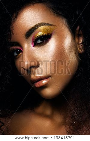 Portrait of a sensual young African woman with colored make up