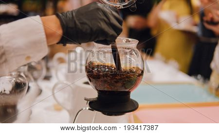 Brewing Black Tea In A Kettle Macro. Degustation Of Tea Close-up