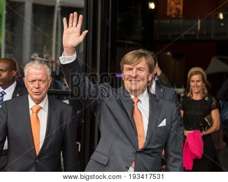DRONTEN, NETHERLANDS - 29 JUNE 2017: King Willem-Alexander of the Netherlands waves to the crowd in front of De Meerpaal in Dronten after the King and Queen's s regional visit to the province of Flevoland