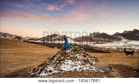 Mongolian Landscape Full Of Livestock Surrounded By Mountain Hills Snow And Beautiful Sunset At Tere