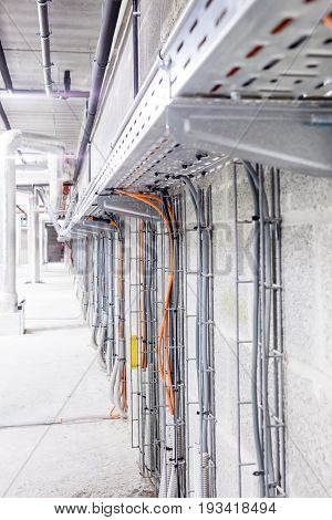 Electrical cables are located in a cableway in a building