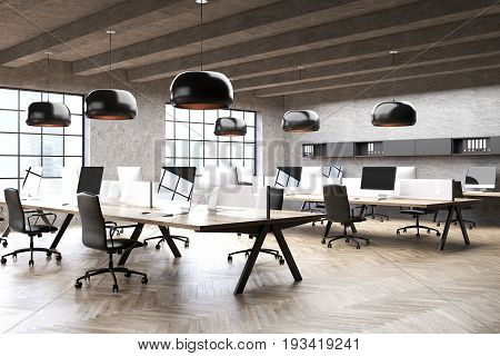 Modern open space office with concrete walls wooden floor and rows of tables with computers on them. Original lamps. Corner. 3d rendering mock up